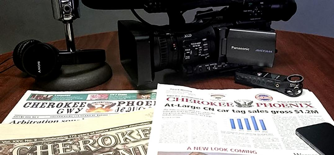 Camera and newspapers