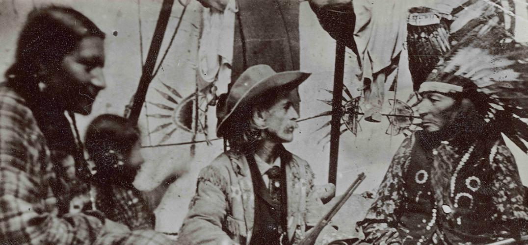 "William ""Buffalo Bill"" Cody talking with one of the Lakota performers in his Buffalo Bill's Wild West show"