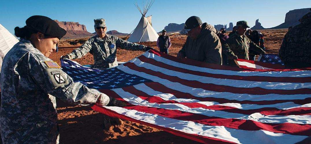Members of the Oljato and Kayenta Veterans Associations refold an American flag
