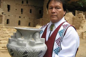 "Joshua Madalena with Best of Show replica pottery of Cliff Palace. 2010, 14"" x 18"""