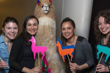 Guests posing with Ande the Llama