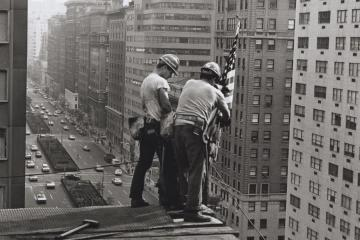 Kahnawake Mohawk ironworkers Jay Jacobs and Sparky Rice place a flag on a building in Midtown Manhattan